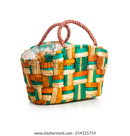 Colorful basket and shopping bag isolated on white background. Single object with clipping path - stock photo