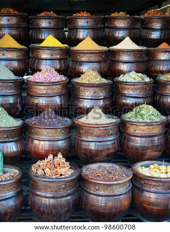 Colorful basket full of spices in traditional market or shop - stock photo