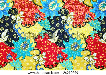 Colorful batik cloth fabric background - stock photo
