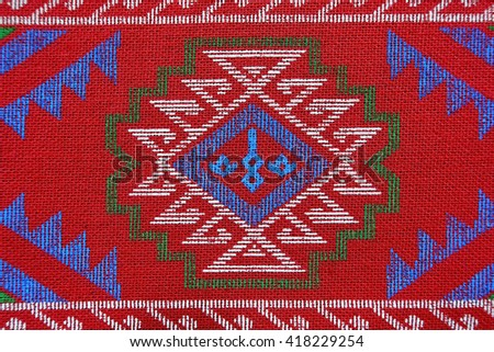 Colorful batik,Sarong fabric pattern background:Close up,select focus with shallow depth of field:ideal use for background.