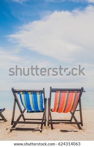 colorful beach chairs on the white sand beach at koh Nang Yuan in Suratthani province Thailand