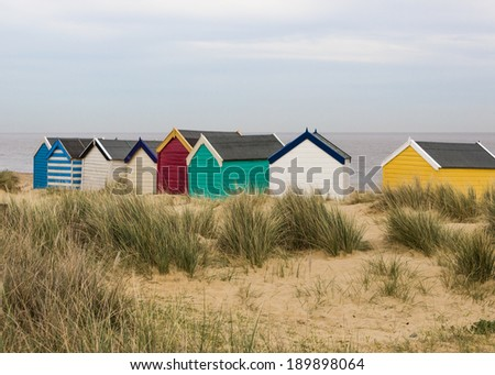 Colorful beach huts at Southwold, Suffolk, England - stock photo