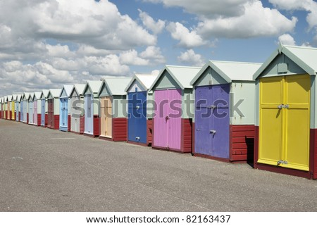 Colorful beach huts on seafront promenade at Hove. Brighton. East Sussex. England - stock photo