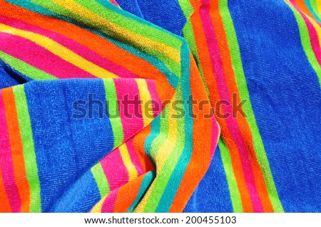 Colorful beach towel useful as a background pattern
