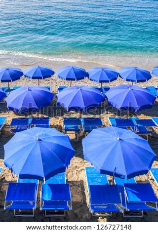 Colorful beach umbrella at the Monterosso beach, Cinque Terre,Liguria, Italy - stock photo
