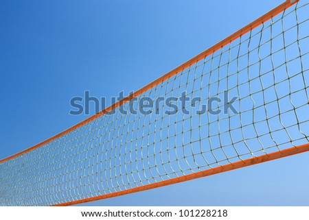 Colorful beach volley net with blue sky. - stock photo