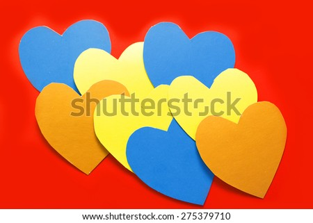 colorful beautiful hearts decomposed into a red background. Valentine's Day