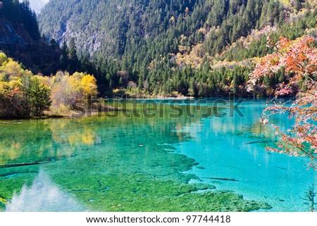Colorful beautiful lake in autumn - stock photo