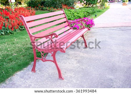 Colorful bench in the park - stock photo