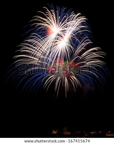 Colorful big fireworks explosion in dark sky background, 4 of July, Independence day, explode, fireworks festival fragment close up with village silhouette in Malta,Malta fireworks festival - stock photo