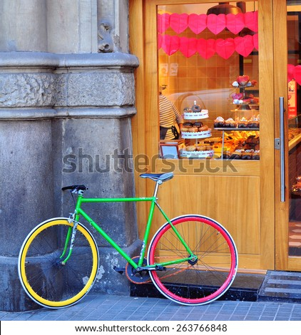 Colorful bike at the bakery on the street - stock photo