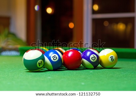 Colorful billiard balls on the pool table - stock photo