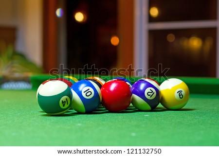 Colorful billiard balls on the pool table - stock photo