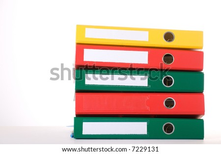 Colorful binders against white background. Office life. - stock photo