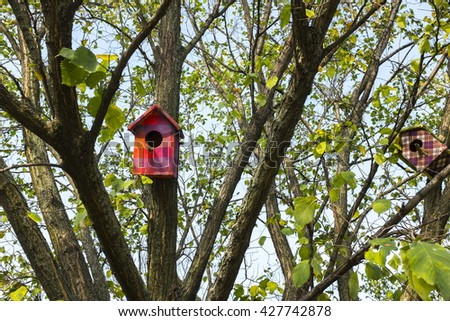 Colorful birdhouse in the park - stock photo