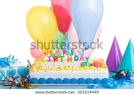 Colorful birthday cake and burning candles with decorations on a white background