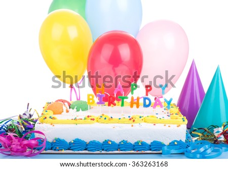 Colorful birthday cake and decorations on a white background - stock photo