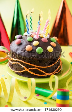 colorful birthday cake with burning candles - stock photo