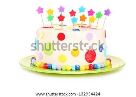 Colorful birthday cake with decorations, isolated on white background - stock photo