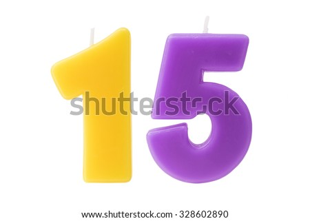 Colorful birthday candles in the form of the number fifteen on white background