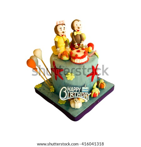 Colorful birthday celebration cake decorated with animal figures for kids party - stock photo