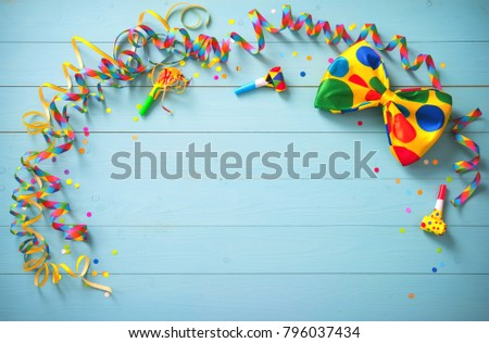 Colorful birthday or carnival background with party items. Festivity concept