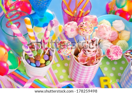 colorful birthday party table with homemade sweets for kids ( top view)