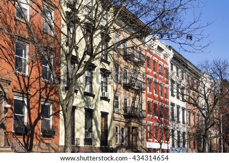 Colorful block of historic buildings along Tompkins Square Park on a bright sunny day in New York City - stock photo