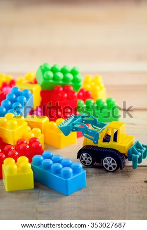 colorful block toy with bulldozer toy bussiness concept