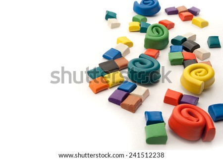 Colorful blocks and spirals of plasticine over white background. - stock photo
