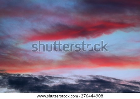 Colorful blood red cloudy sky in the evening - stock photo