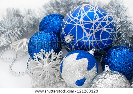 Colorful blue christmas decoration baubles on white - stock photo