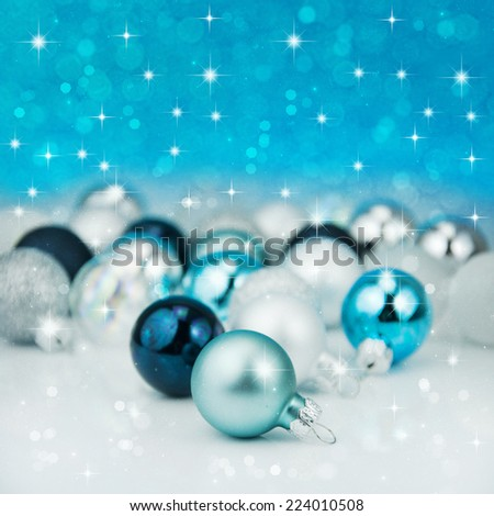 Colorful blue christmas decoration baubles on white. - stock photo