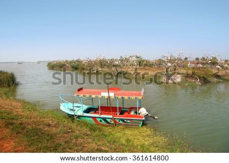 Colorful boat at kolleru lake and bird sanctuaryin India - stock photo
