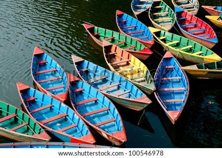 colorful boats in Phewa Lake, Nepal - stock photo