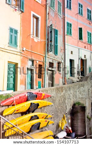 Colorful boats on the stone wall at Riomaggiore.