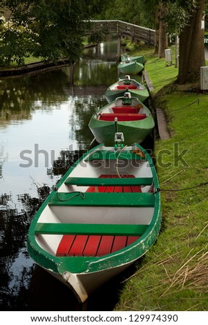 Colorful boats which are used for transportation in the Giethoorn, the city without streets, in Holland. - stock photo