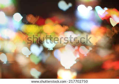 Colorful bokeh bird shape ,city  at night - stock photo