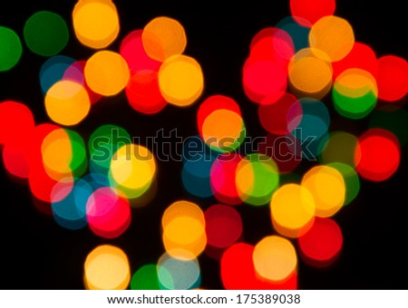 Colorful bokeh light on black background.