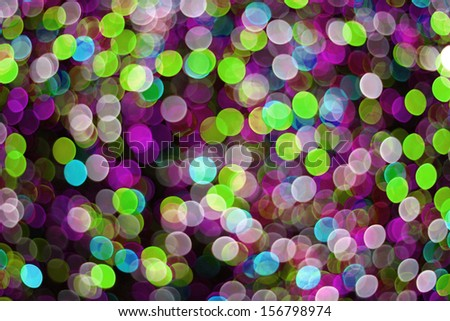 colorful bokeh lights in green and purple - stock photo