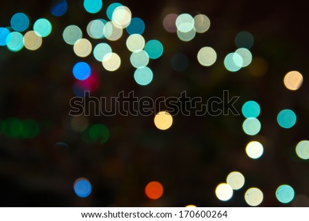 colorful bokeh on black background  - stock photo