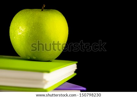 Colorful book with green apple