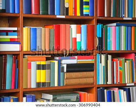 Colorful Books at Bookshelf in Library - stock photo