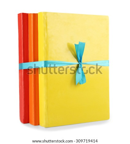 Colorful books isolated on white - stock photo
