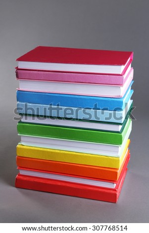 Colorful books on gray background - stock photo