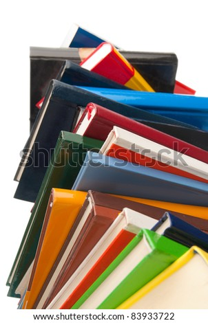 Colorful Books stacked one over the other isolated on white