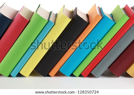 Colorful books with lots of copyspace for your own text on the book spines - stock photo