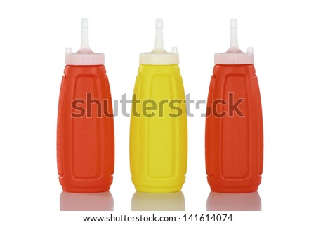 colorful bottles of Ketchup and Mustard. Isolated on White - stock photo