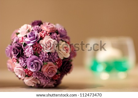Colorful bouquet ball with candle in wedding party - stock photo