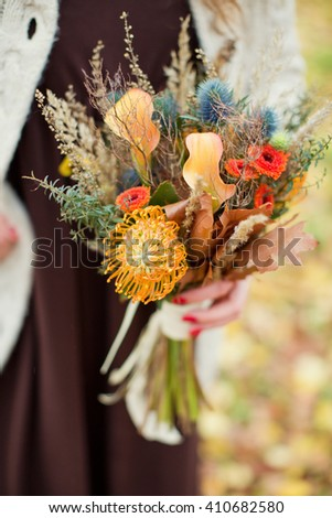 Colorful bouquet in the hands